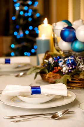 Elegant blue and white Christmas table setting  by candle light for Christmas dinner