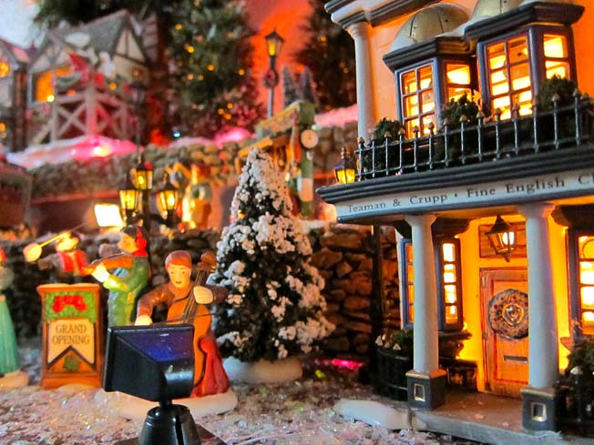 Christmas caroler in a porcelain village