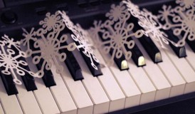 Snowflake garland on a piano