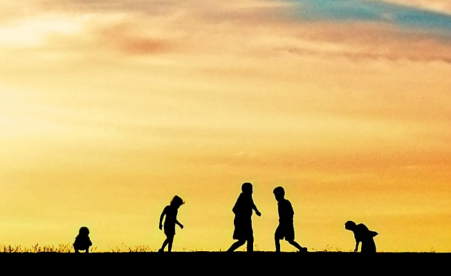 Children playing in the summer sunset