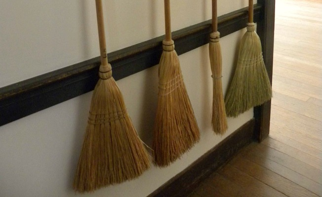 A row of brooms, tiptoeing toward the light