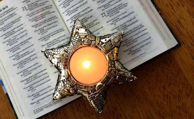 Jerusalem Candle on an Open Bible